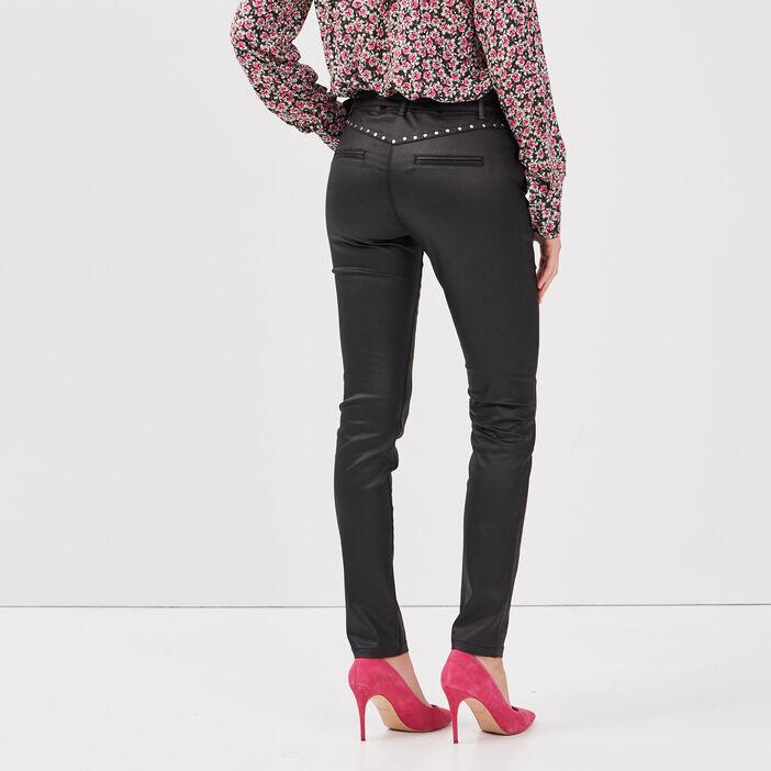 Pantalon enduit ajusté avec clous noir femme